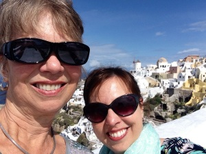 """My mom and I, with the windmill on the cover of """"Murder in Santorini"""" in the background"""